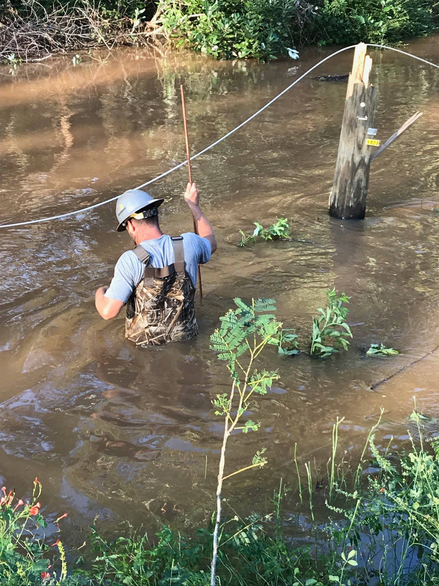 Diverse Power and assisting crews battled all sorts of obstacles while restoring power following Hurricane Michael, including wading through swamps to repair lines.