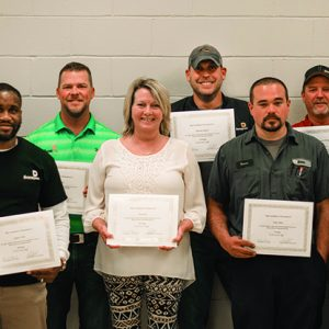 front row, from left, Anthony Talley (10 years of service), Paula May (15 years of service), Tanner Hicks (5 years of service) and Ben Shadrick (15 years of service). Back row, from left, Matt Phillips (20 years of service), Brent Loftin (20 years of service), Shannon Anthony (15 years of service) and Tim Reeves (5 years of service). Not pictured: Brannon Horne (10 years of service), Jamin Blair (15 years of service), Jimmy Hutto and Bubba Allen (20 years of service).