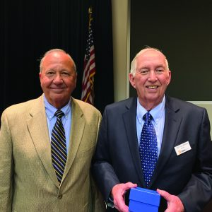 Roy Tollerson holding distinguished cooperator award